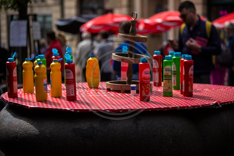 Table with sauce bottles